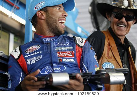 June 09, 2017 - Long Pond, PA, USA: Darrell Wallace, Jr. (43) and Richard Petty look over speed charts during practice for the Pocono 400 at Pocono Raceway in Long Pond, PA.