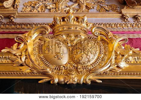 Paris, France, March 28 2017: Golden ceiling Royal Chateau at the Palace of Versailles near Paris.