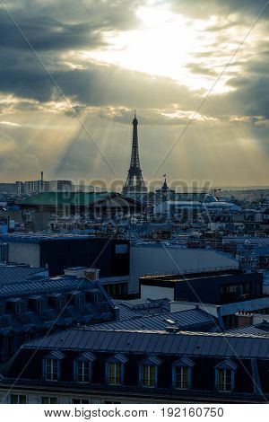 Aerial View Of Paris. Paris Skyline With Roofs And The Eiffel Tower On A Cloudy Day. Panorama From T