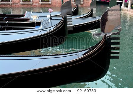 Venice Italy,October 16th 2013.The prows of  gondolas sit in waiting for tourists in the romantic city of Venice Italy.