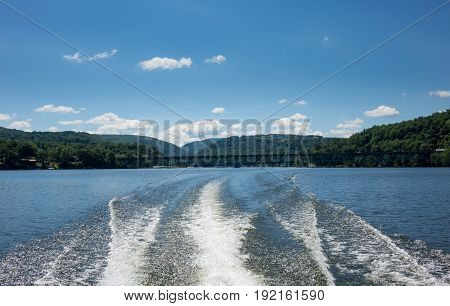 Wake and wash behind speeding boat on Cheat Lake near Morgantown, West Virginia