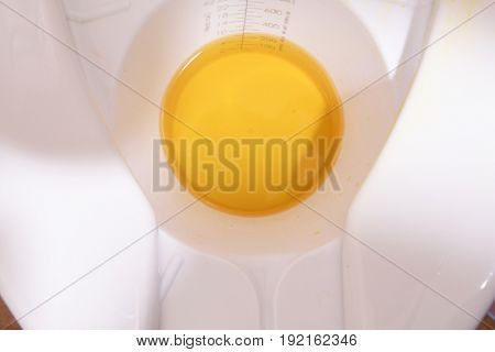 Plastic hat in a hospital toilet containing a urine sample