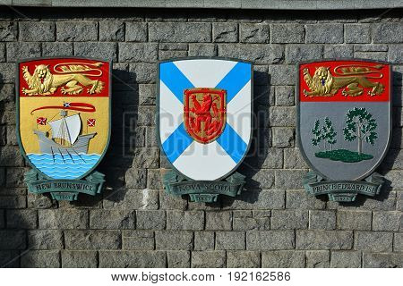 Victoria BC,Canada,January 23rd 2017.The coats of arms for the Canadian provinces of New Brunswick,Nova Scotia and Prince Edward island hang from a wall in Victoria BC,Canada