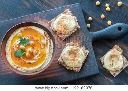 Bowl of hummus on the wooden table