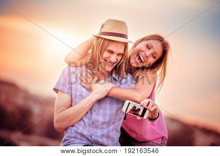 Couple in love taking selfie.sSummer holidays technology love and dating concept.