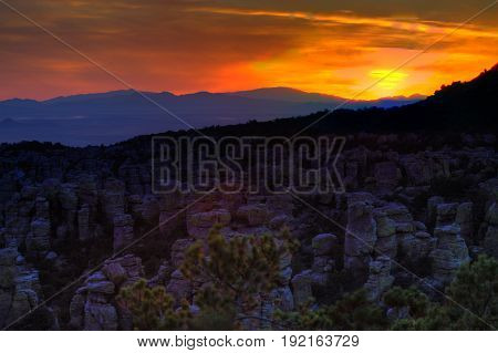 Mountain Sunset with Purple Hills and Orange Sky