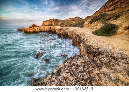 Algarve, Portugal: rocks in the coast of Albufeira at sunrise