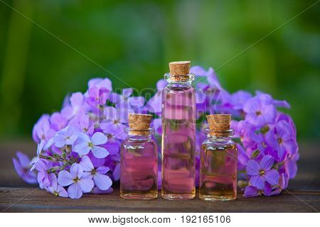 Essence Of Flowers On Table In Beautiful Glass Jar