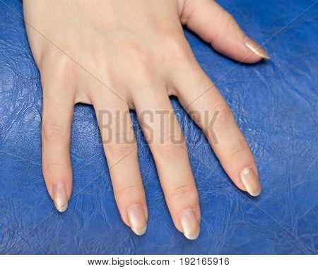 nail polish on their fingers . A photo