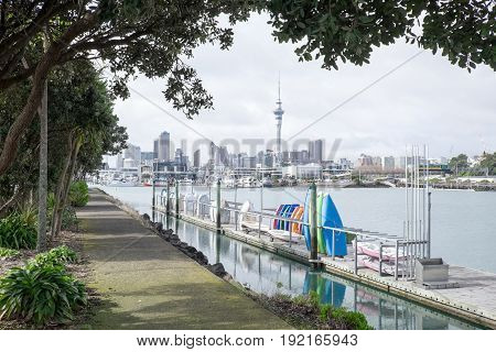 Dinghies and boats at Westhaven Marina with Auckland CBD skyline - New Zealand NZ
