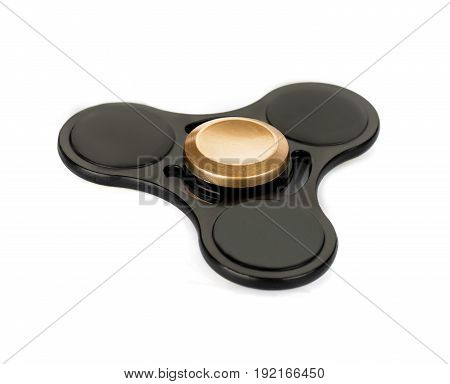 Black fidget spinner stress relieving toy isolated on white background