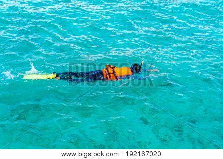 Snorkeling in tropical Maldives island