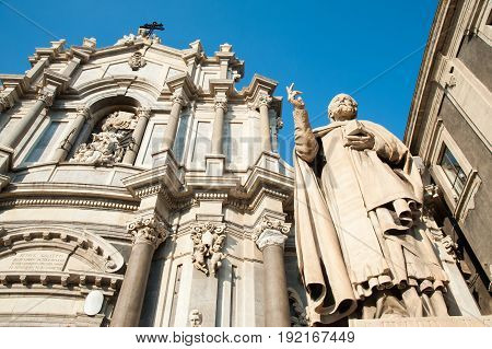 Statues outside Saint Agatha Church in Catania Sicily with a view of the facade