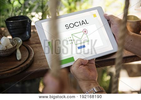 People using tablet with email and notification icon