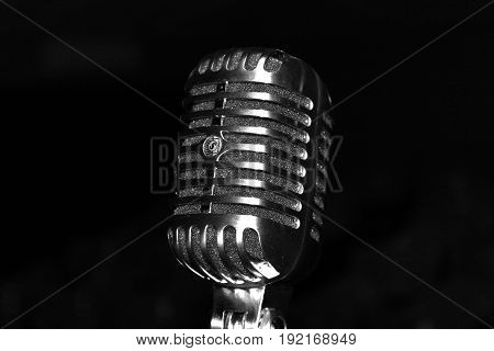 Microphone from the 50's against a black background