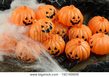 Plastic jack o' lanterns Halloween decorations with spider cobweb decorations