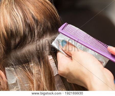 weave hair in a beauty salon, hair color. A photo