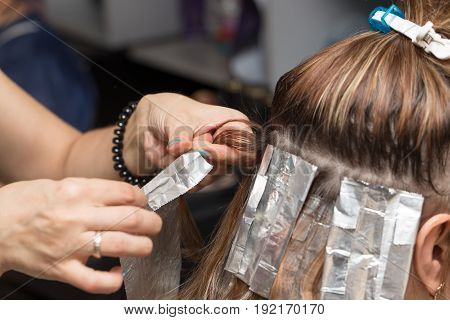weave hair in a beauty salon, hair color . A photo