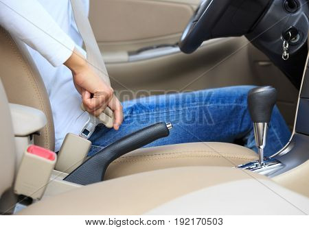Woman driver buckle up the seat belt driving car