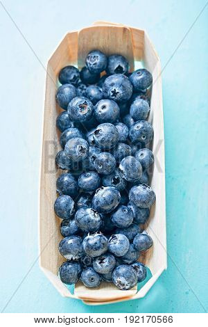 Fresh blueberries on blue background page layout
