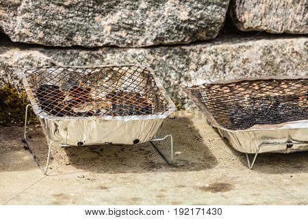 Grill trays on rocks and stones table in nature. Meal during traveling