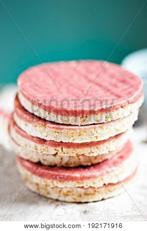 Stack of berry yoghurt coated rice cake