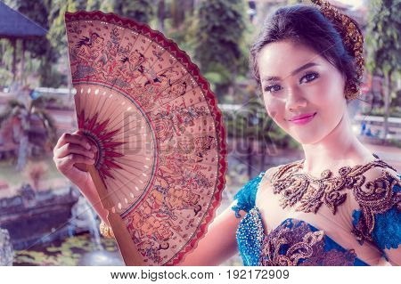 BALI, INDONESIA - MARCH 08, 2017: Unidentified beautiful woman in Kertha Gosa Pavilion in Klungkung Palace, in Denpasar Indonesia.