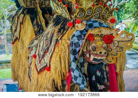 BALI, INDONESIA - MARCH 08, 2017: Typical balinese costumes made of grains of rice, beans and corns inside of the Royal temple of Mengwi Empire located in Mengwi in Bali, Indonesia.