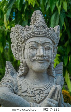 BALI, INDONESIA - MARCH 08, 2017: Close up of a beautiful stone statue inside of the Royal temple of Mengwi Empire located in Mengwi in Bali, Indonesia.