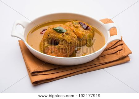 south indian food called vada sambar or sambar vada or wada dipped in sambar with coconut, green and red chutney and south indian style hot coffee, selective focus
