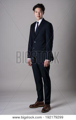 East Asian businessman shooting studio portrait photo