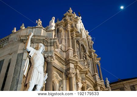 Night view of an external statue in the facade of Saint Agatha Church in Catania Sicily