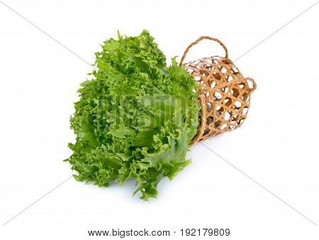 fresh green frilly iceberg lettuce with bamboo basket on white background
