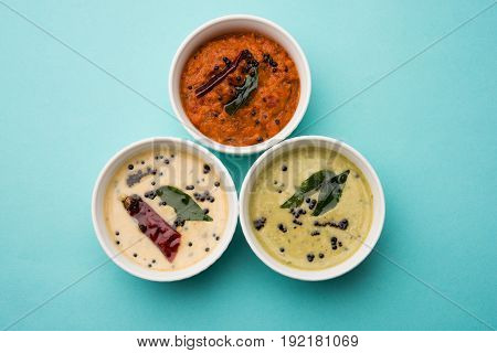 coconut, tomato and mint chutney served as a side dish and important combination for south indian food like upma  or dosa, idli, vada and uttapam