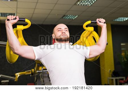 man with weight training in gym equipment sport club.
