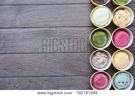 Top view Ice cream flavors in cup on wood table