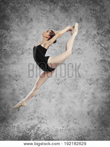 Young ballet dancer on grunge background