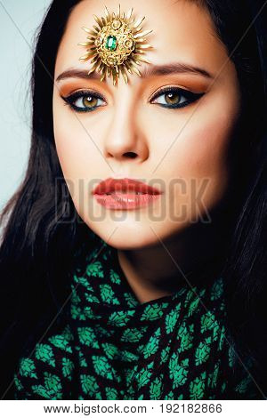beauty eastern muslim woman with jewelry close up, bride with star creative makeup, modern art concept