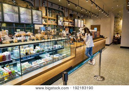SEOUL, SOUTH KOREA - CIRCA JUNE, 2017: display case at Starbucks in Seoul. Starbucks Corporation is an American coffee company and coffeehouse chain.