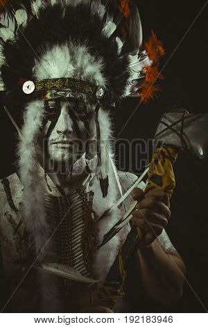 Chieftain Aboriginal, American Indian with plume of feathers, ax and war paintings