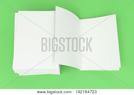 Stack Of Blank White Closed And One Open Brochure Mock-up On Green Background