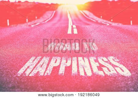 Happiness written on desert road. Toned. Vertical