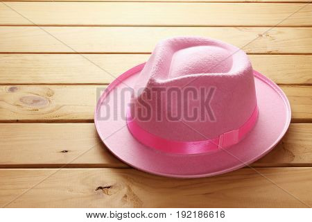 Pink Fedora Hat on a Wooden Background