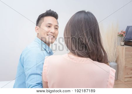 Romantic Honeymoon Of Asian Couple Lovers,husband Looking His Wife Face With Sweet Eyes In Bedroom.