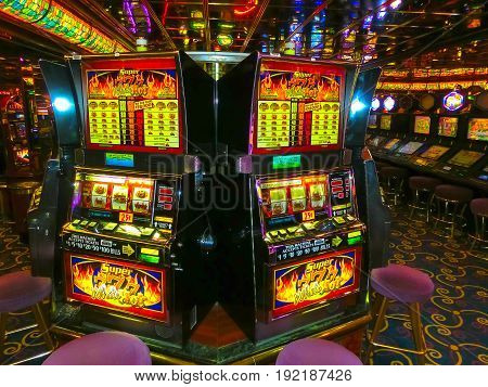 Venice, Italy - June 06, 2015: Cruise ship Splendour of the Seas by Royal Caribbean International at port Venice, Italy on June 06, 2015. The details of interior of cruise ship. The interior at casino with slot machines inside the ship