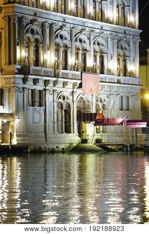 night landscape with the image of building on a channel embankment in Venice, Italy