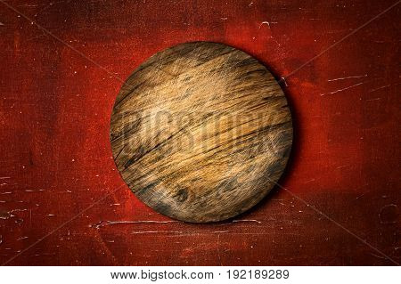 Rustic Round Cutting Board On Vintage Red