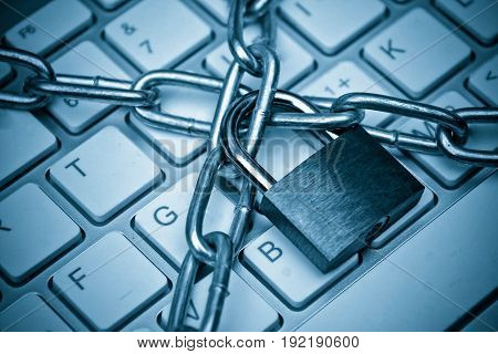 Security lock and chained on computer keyboard - computer data security concept