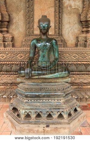 ancient sitting Buddha in Wat Sisaket temple, Vientiane, Laos