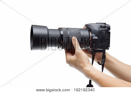Male hands holding a digital camera with zoom lens